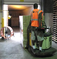 GSI Warehouse worker moving pallet